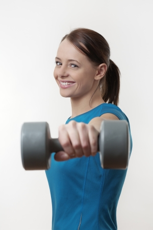 attractive woman doing a workout routine with a  dumbbell weights Stock Photo - 17079739