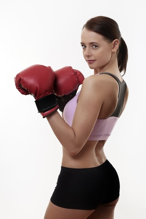 sporty woman keeping her body fit doing boxing photo
