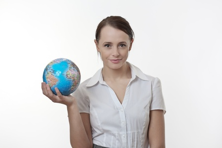woman holding up a jigsaw globe puzzle  Stock Photo - 17079940