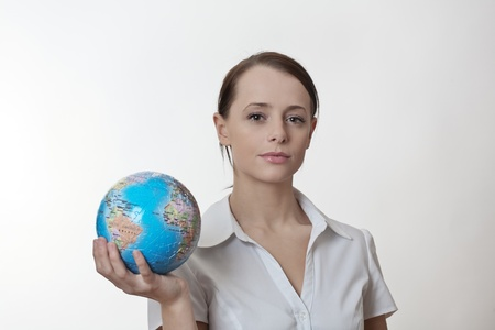 woman holding up a jigsaw globe puzzle  photo