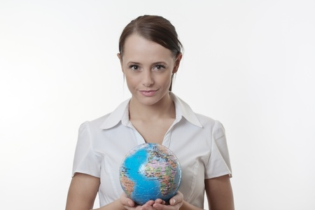 woman holding up a jigsaw globe puzzle Stock Photo - 17079921