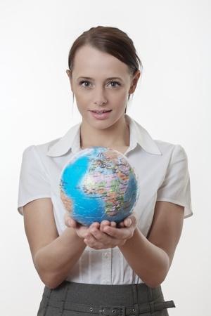 woman holding up a jigsaw globe puzzle Stock Photo - 17079768