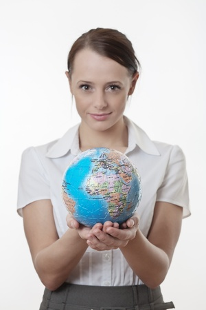 woman holding up a jigsaw globe puzzle  Stock Photo - 17079792
