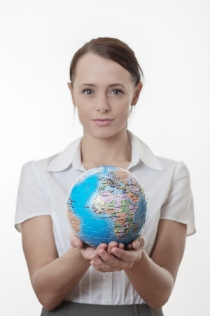 woman holding up a jigsaw globe puzzle Stock Photo - 17079830