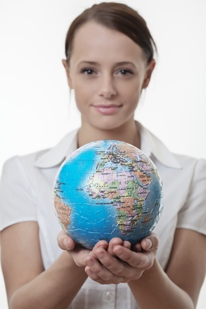 woman holding up a jigsaw globe puzzle  Stock Photo - 17079711