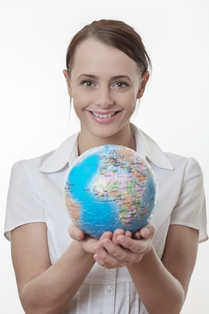 woman holding up a jigsaw globe puzzle  Stock Photo - 17079777