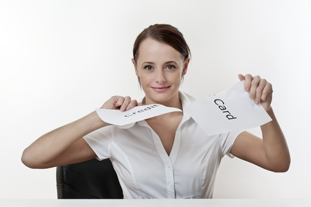 woman sitting at a desk getting rid of her credit card worries Stock Photo - 17079908