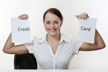 woman sitting at a desk getting saying no to credit card Stock Photo - 17079912