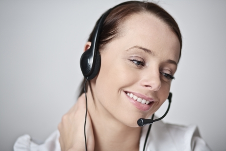 Support phone operator in headset happy in her work Stock Photo - 17079717