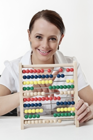 young attractive woman using a wooden abacus to count and add up her sums photo