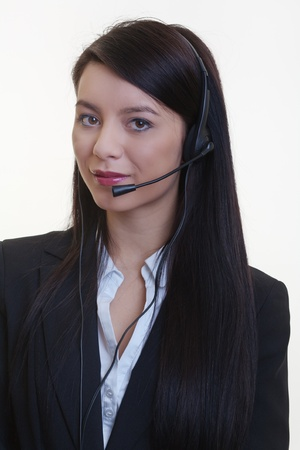 portrait of a young businesswoman wearing a phone headset Stock Photo - 17456515