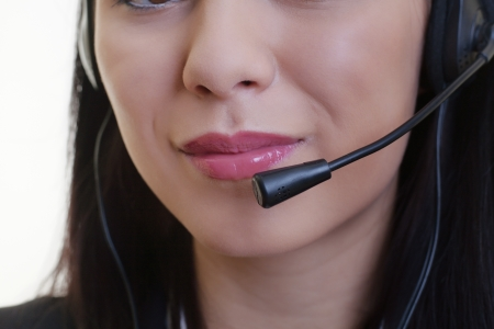 close up of a woman mouth using a phone headset to talk Stock Photo - 17456508