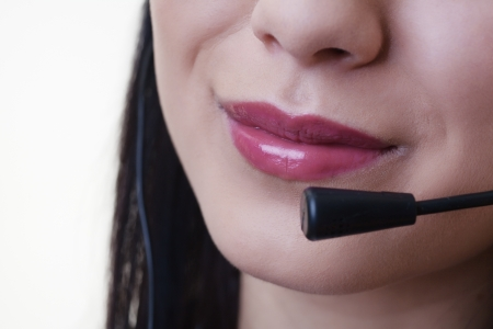 close up of a woman mouth using a phone headset to talk Stock Photo - 17456536