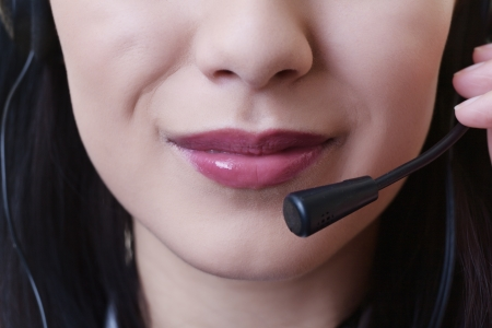 close up of a woman mouth using a phone headset to talk Stock Photo - 17456516