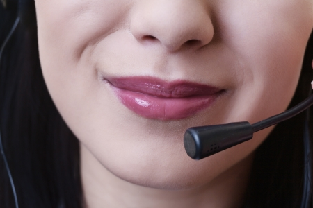 close up of a woman mouth using a phone headset to talk Stock Photo