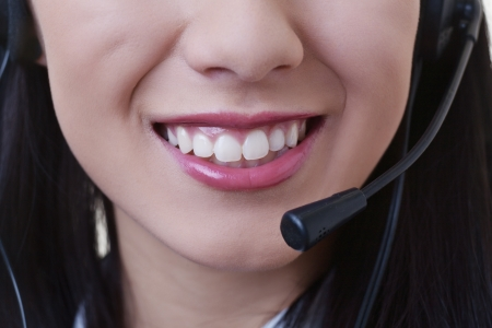 close up of a woman mouth using a phone headset to talk Stock Photo - 17456518