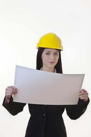 woman holding plans of woman holding plans of some sort wearing a hard hat Stock Photo - 17456457