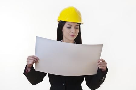 woman holding plans of woman holding plans of some sort wearing a hard hat Stock Photo - 17456455