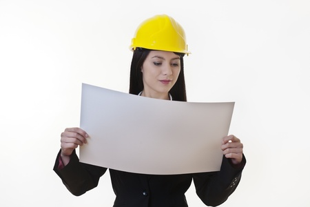 woman holding plans of woman holding plans of some sort wearing a hard hat Stock Photo - 17456455