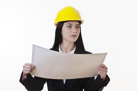 woman holding plans of woman holding plans of some sort wearing a hard hat Stock Photo - 17456452
