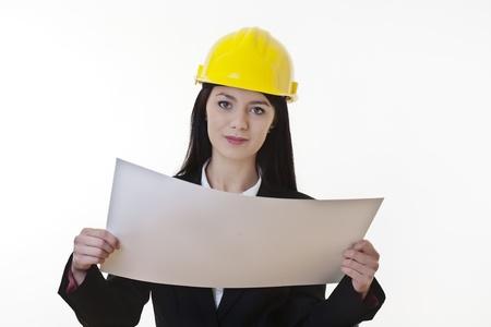 woman holding plans of woman holding plans of some sort wearing a hard hat Stock Photo - 17456451
