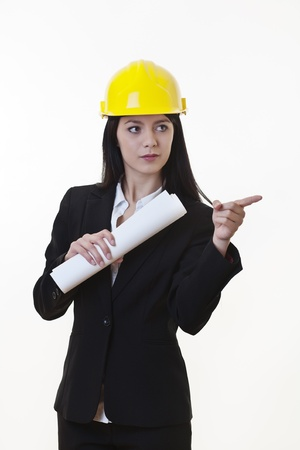 woman holding plans of woman holding plans of some sort wearing a hard hat Stock Photo - 17456469