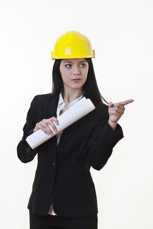 woman holding plans of woman holding plans of some sort wearing a hard hat Stock Photo - 17456469