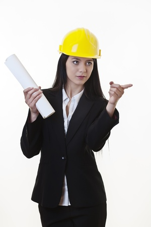 woman holding plans of woman holding plans of some sort wearing a hard hat photo
