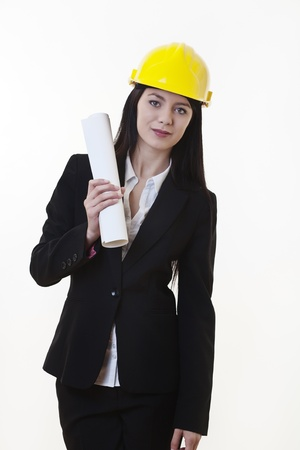 woman holding plans of woman holding plans of some sort wearing a hard hat Stock Photo - 17456467