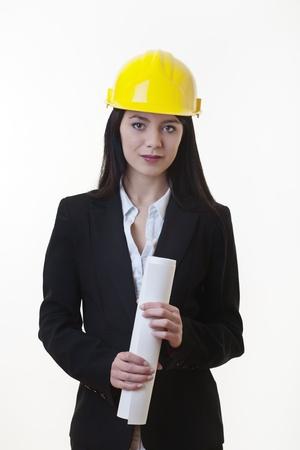 woman holding plans of woman holding plans of some sort wearing a hard hat Stock Photo - 17456466