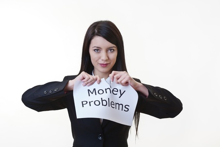 woman holding up a piece of paper with the words money problems written on it and tearing the sheet of paper in half