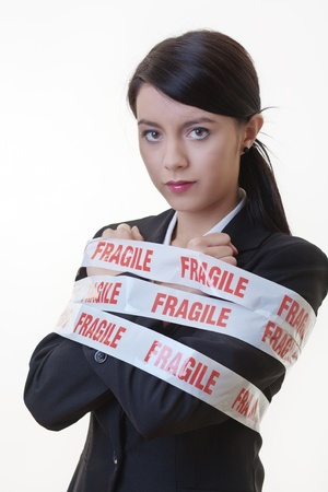 business woman wrapped up in fragile tape Stock Photo - 17456539