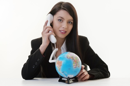 woman using a phone and the cord connected to a globe Stock Photo - 17456496