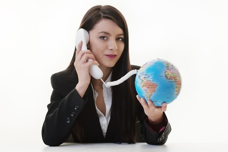 woman using a phone and the cord connected to a globe Stock Photo - 17456497