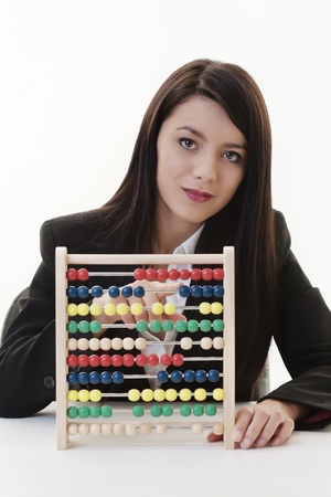 business woman at a desk using a abacus  photo