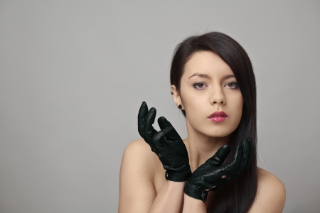 black gloves: beauty headshot of sexy woman wearing leather driving gloves