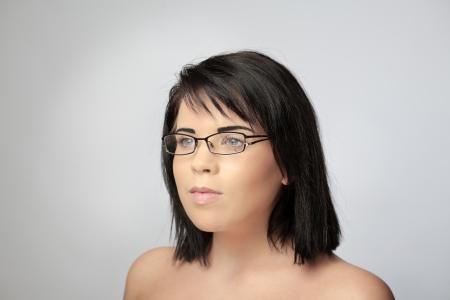 eye wear: sexy woman shot in the studio wearing broken eye wear Stock Photo