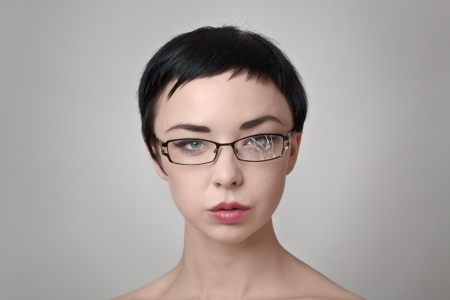 sexy woman wearing broken glasses photo
