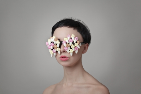 sexy woman with sort hair wear glasses made up from sweets photo