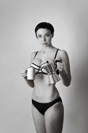 beautiful young woman making coffee in her underwear photo