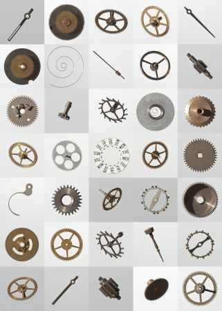 clock gears: small watch cogs and other parts, looking down from above background