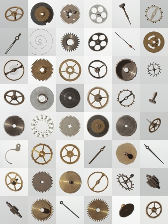gearwheel: small watch cogs and other parts, looking down from above background