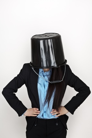 business woman in a suit with a bucket on her head? photo