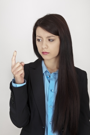 business woman in a suit with a plaster around her finger photo