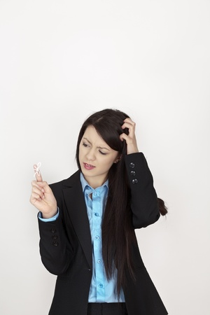 business woman with string bow tied to her finger to remind her to do something at work photo