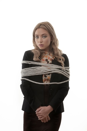 tied woman: Business woman tires up at work not looking to happy