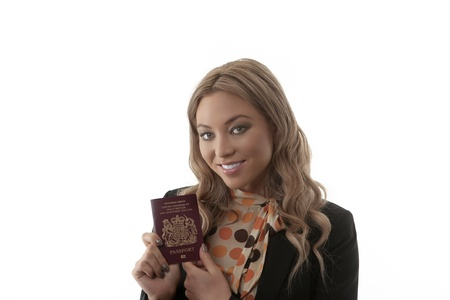 tourist destinations: Woman clutching a passport in anticipation of the freedom of adventure and travel in foreign countries and tourist destinations Stock Photo