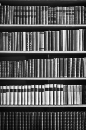 bookcase with many old books in a  library Standard-Bild