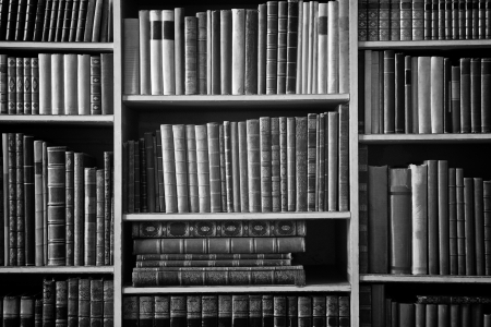 bookcase with many old books in a  library photo
