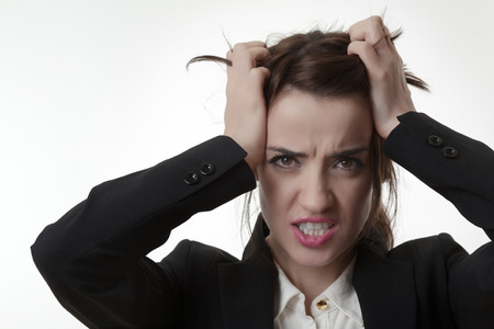 fedup: sexy frustrated woman office worker pulling out her hair not very happy Stock Photo